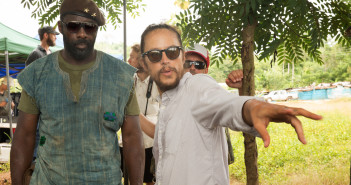 "Carey Fukunaga (right) pictured with Idris Elba (left) on the set of ""Beasts of No Nation.""  Photo courtesy of Netflix"